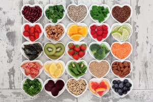 foods high in key nutrients in heart shaped bowls