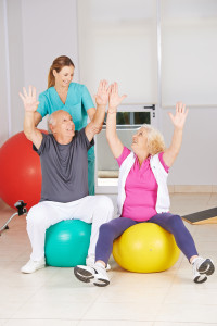 seniors learning seated exercises