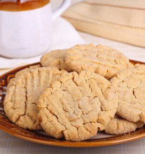 Peanut butter cookies on a plate with cup in background